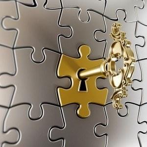 Golden key on puzzle part